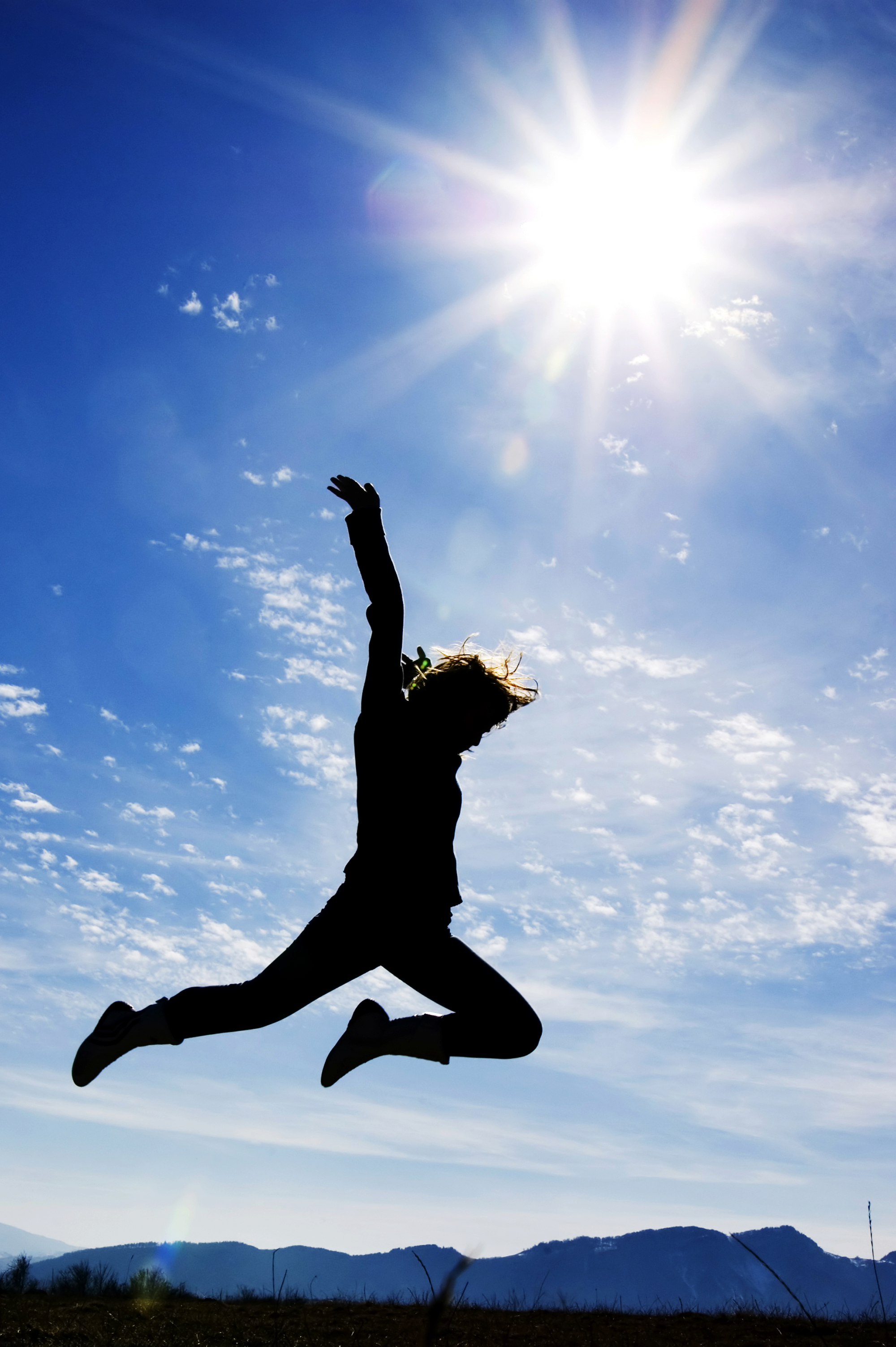 girl jumping blue sky