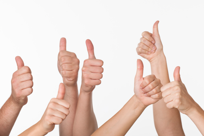 People Giving Thumbs-up